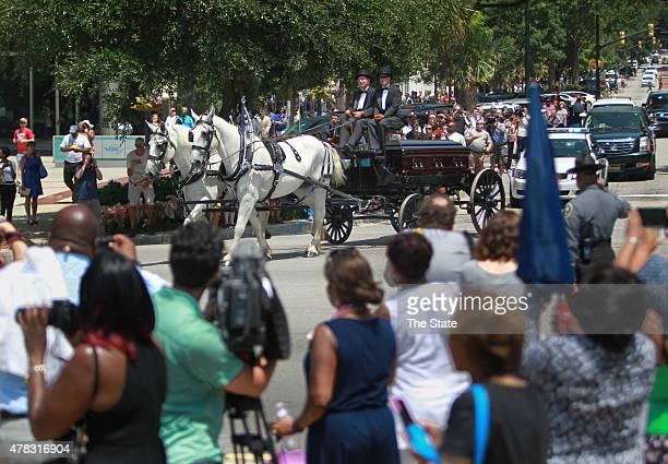 A horsedrawn carriage brings the casket of Sen Clementa Pinckney to the South Carolina State House on June 24 2015 in Columbia SC