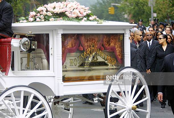 A horsedrawn carriage carries RB singer Aaliyah''s coffin towards St Ignatius Loyola Church August 31 2001 during her funeral in New York City The...