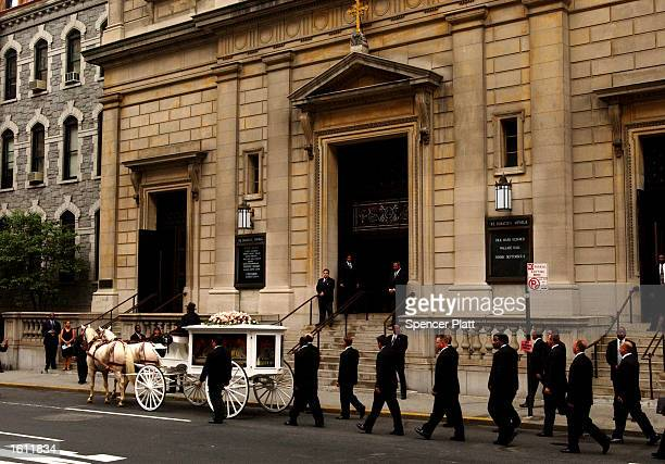 A horsedrawn carriage carries RB singer Aaliyah''s coffin towards the St Ignatius Loyola Church for services August 31 2001 in New York City The...