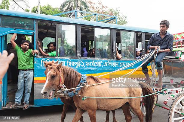 CONTENT] Horsedrawn carriage Dhaka Street Photography Dhaka Bangladesh Indian SubContinent Asia Dhaka is the capital of Bangladesh a mega city...