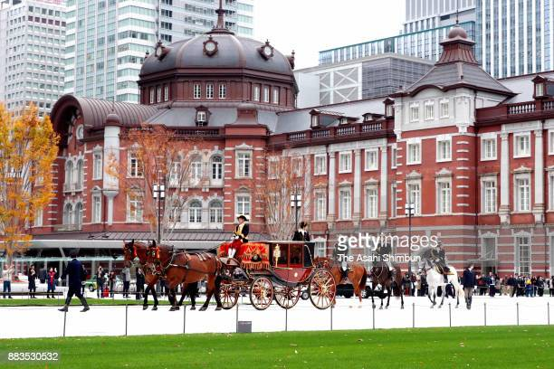 A horsedrawn carriage marches in front of Tokyo Station toward the Imperial Palace during a rehearsal prior to its route returning on December 1 2017...