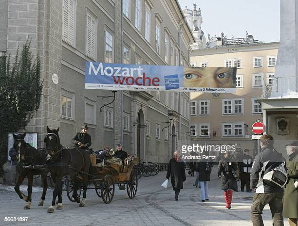 A horsedrawn carriage rides through the city at the opening of the Mozart week on January 27 2006 in Salzburg Austria Salzburg celebrates the 250th...