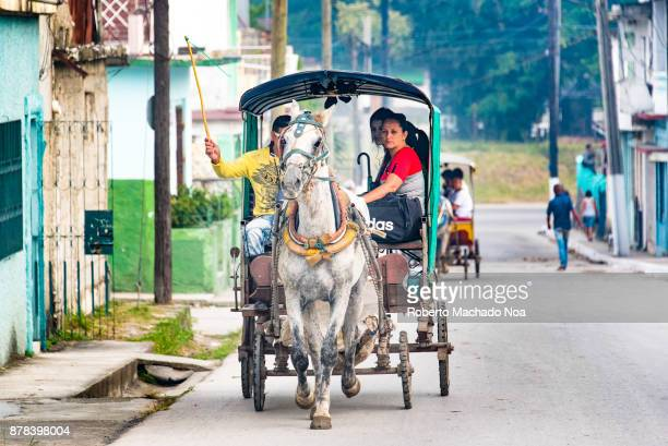 Horsedrawn carriage transporting passengers to the Hospital Area in the city The scene is captured in the Vigia Neighbourhood