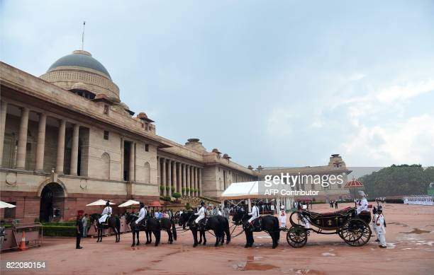 A horsedrawn carriage waits for India's new President Ram Nath Kovind during a ceremony at the Presidential Palace in New Delhi on July 25 2017 Ram...