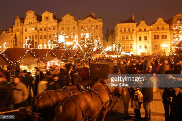 Horsedrawn carriages wait for customers at the Christmas market on Pragues Old Town Square December 15 in the Czech Republic Christmas which was...