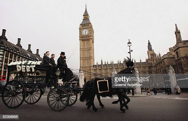 A horsedrawn hearse travels through Westminster January 2005 in London The World Development Movement together with Jubilee Debt Campaign and Oxfam...