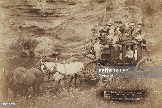 Horsedrawn stagecoach carrying by formally dressed women children and men