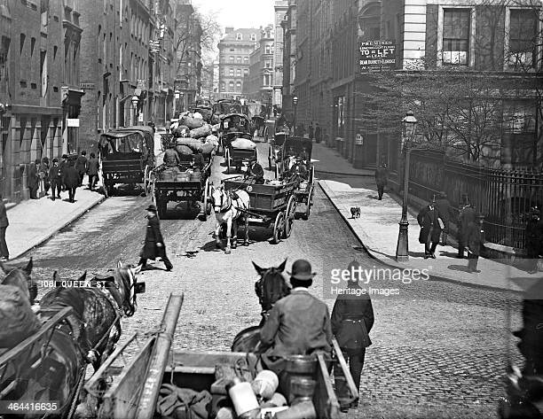 Horsedrawn vehicles in Queen Street London EC4 18701900 A policeman directs the traffic in central London Even before the car was a common feature of...