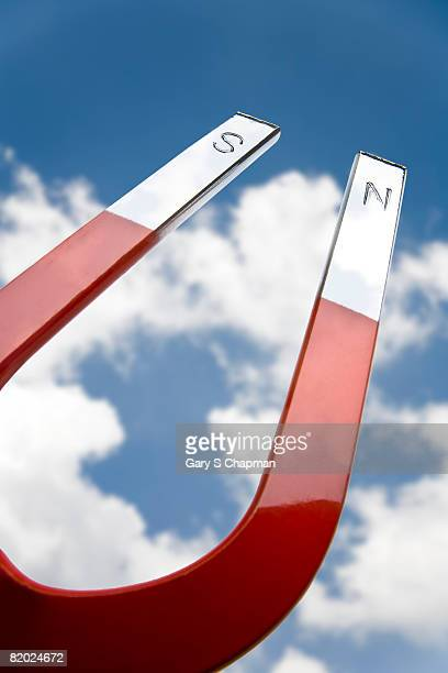 horsehoe magnet facing sky - horseshoe magnet stock pictures, royalty-free photos & images