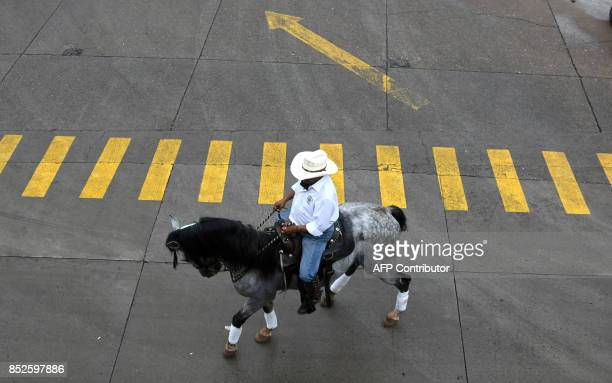 Horseman arrives to participate in a carnival to commemorate the 439th anniversary of the foundation of the city in Tegucigalpa, on September 23,...