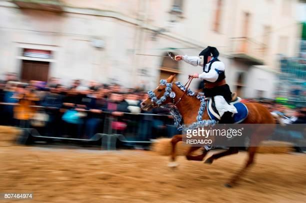 Horseman gallops to pierce the star with his sword Sartiglia feast Oristano Sardinia Italy Europe
