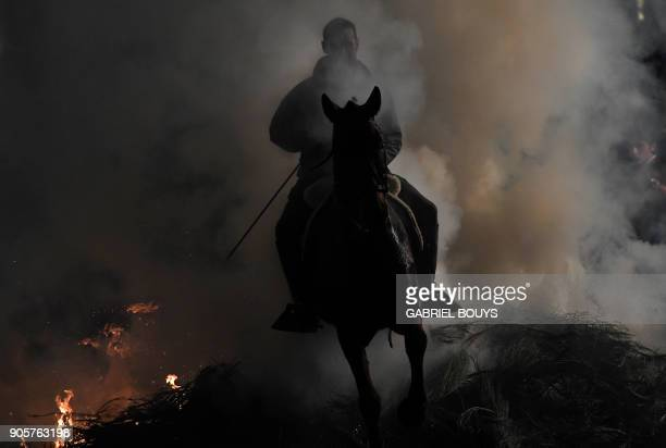 A horseman jumps over a bonfire in the village of San Bartolome de Pinares in the province of Avila in central Spain during the opening of the...