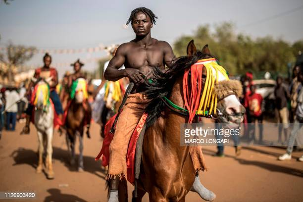 Horseman prepares to parade for the opening ceremony of the FESPACO The Panafrican Film and Television Festival of Ouagadougou, on February 23, 2019....