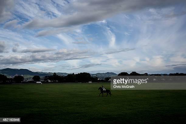 A horseman trains for the Kacchukeiba ahead of the Soma Nomaoi festival at Hibarigahara field on July 24 2015 in Minamisoma Japan Every summer the...