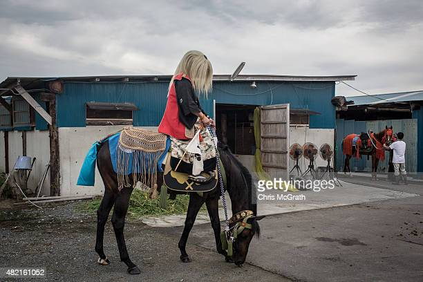 A horseman waits to join a procession to the Ohta Shrine ahead of the days activities at the Soma Nomaoi festival on July 25 2015 in Minamisoma Japan...