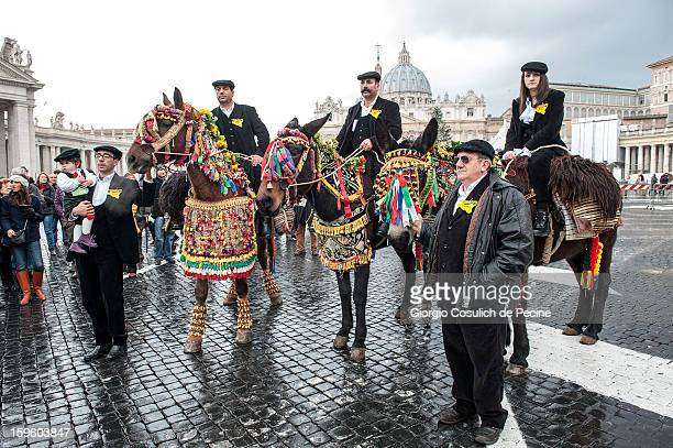 Horsemen dressed in traditional Sicilian costumes pose with their horses for a picture in front of the Saint Peter Basilica during a traditional day...