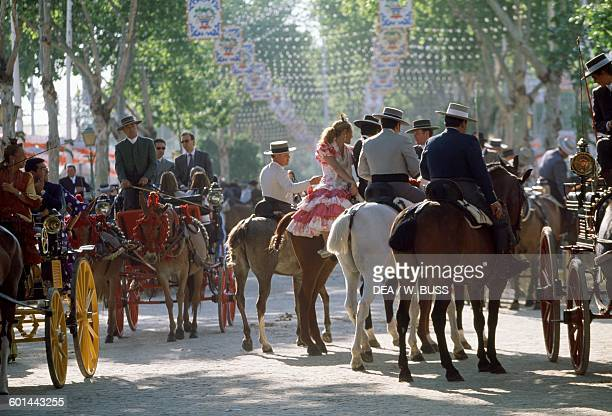 Horsemen in traditional costume at the Feria de Abril Seville Andalusia Spain