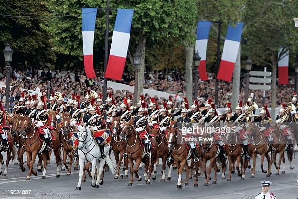 Horsemen of the French Republican Guard ride their horses the ChampsElysees during the annual Bastille day parade on July 14 2011 in Paris France The...