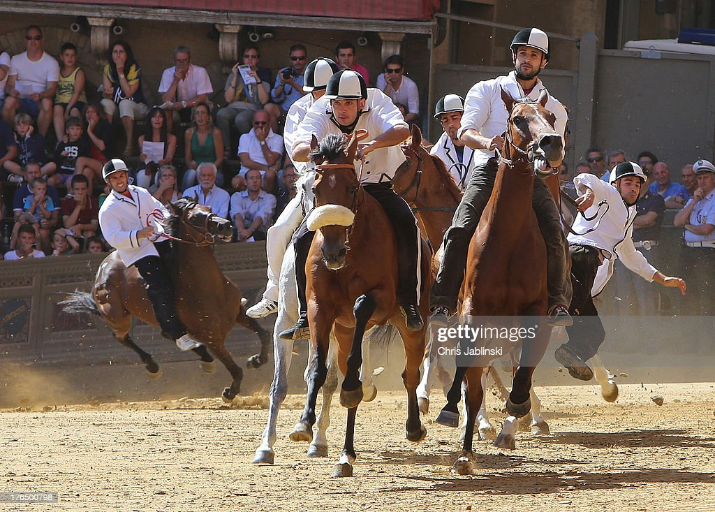 Horsemen ride in a rehearsal known as the batterie before the Tratta on August 13, 2013 in Siena, Italy. The so-called Tratta, in which the ten horses are allocated to the varying city districts or contrada is a precursor to the Palio di Siena, a twice annual summer event, in which riders representing city districts compete, in a tradition that dates back to 1656.