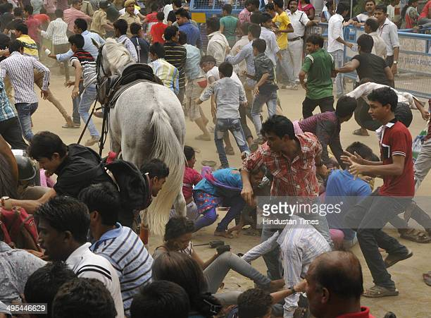 A horsemounted police man evicting the mob from the front of Eden Garden during felicitation ceremony of the IPL champions Kolkata Knight Riders on...
