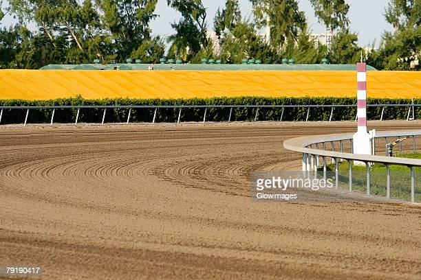 horseracing track in a stadium - horse racecourse stock photos and pictures