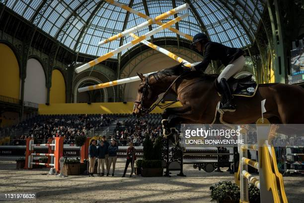 A horserider performs during 'Le Saut Hermes' horse jumping show under the glass canopy of the Grand Palais in Paris on March 22 2019