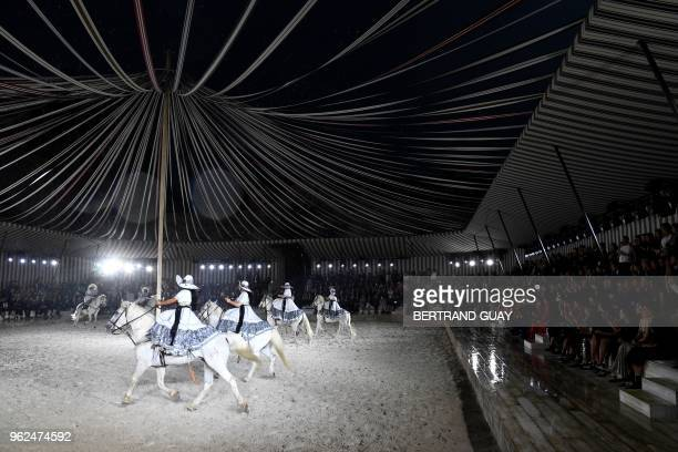 Horseriders perform during the 2019 Dior Croisiere fashion show on May 25 2018 at the Grandes écuries de Chantilly near Paris