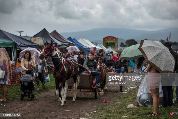Horses and carts make their way through the stands during the annual Appleby Horse Fair on June 07, 2019 in Appleby-in-Westmorland, England. The...