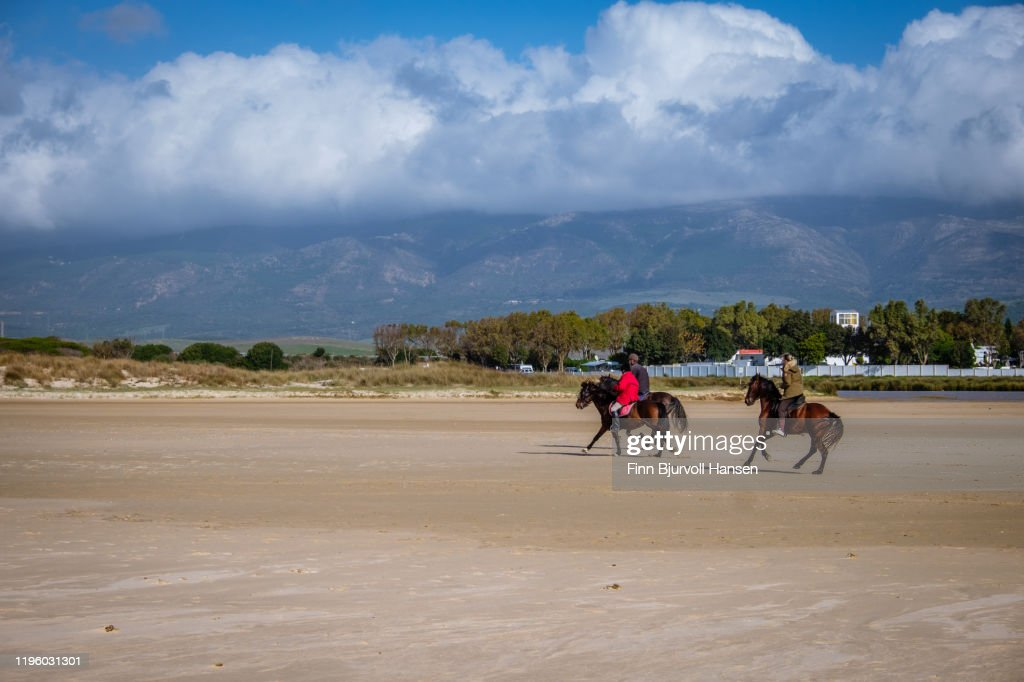 Horses and horseriding from riding school on the beach of Los Lanches in Tarifa : Stock Photo