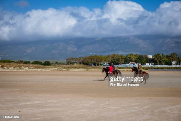 horses and horseriding from riding school on the beach of los lanches in tarifa - finn bjurvoll stock pictures, royalty-free photos & images