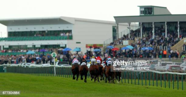 Horses and jockeys make their way down the course during the digibet Handicap Stakes on day two of the July Meeting at Great Yarmouth Racecourse