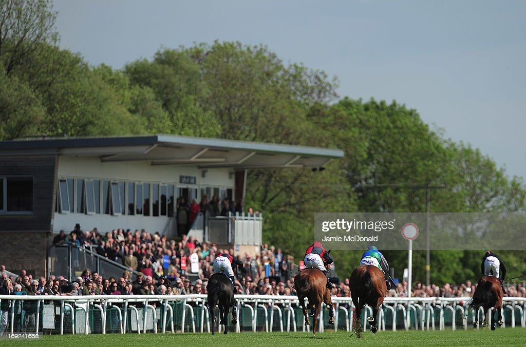 Horses and jockeys race past the Huntingdon Grand stand during racing at Huntingdon race course on May 22, 2013 in Huntingdon, England.