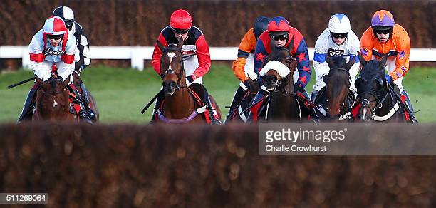 Horses and Jockeys ride in The 'UBIQUE' Handicap Steeple Chase at Sandown Park on February 19 2016 in Esher England