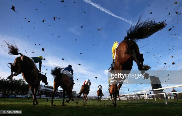 Horses and riders clear a fence during The Tanners Wines Handicap Steeple Chase at Ludlow Racecourse on December 19 2018 in Ludlow England