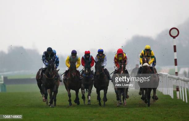 Horses and riders compete during The Watch Racing Uk Anywhere Maiden Hurdle Race at Haydock Racecourse on December 5 2018 in Haydock England