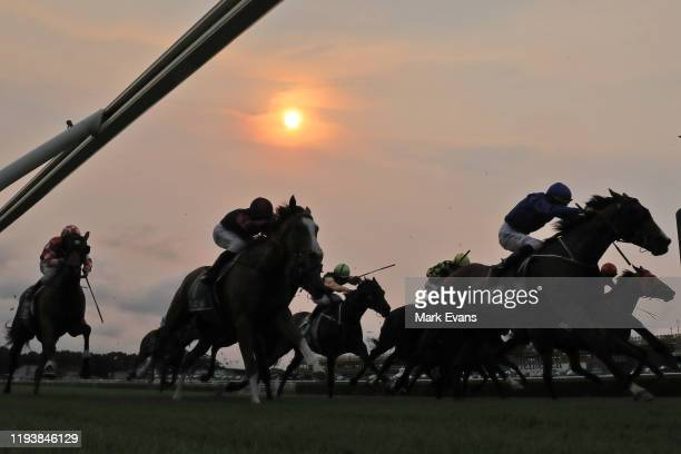 Horses and riders compete in the last race of the day during Sydney Racing at Royal Randwick Racecourse on December 14, 2019 in Sydney, Australia.