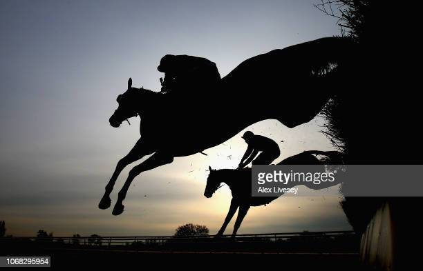 Horses and riders jump a fence during the Bet At toalscom Mares' Handicap Steeple Chase at Southwell Racecourse on December 4 2018 in Southwell...