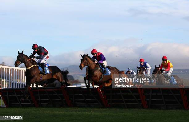 Horses and riders jump a fence during The G C Rickards Ltd EBF Mares' 'National Hunt' Novices' Hurdle Race at Ludlow Racecourse on December 19 2018...