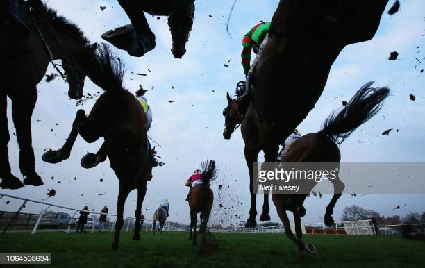 Horses and riders jump a fence during The Injured Jockeys Fund Handicap Steeple Chase at Catterick Racecourse on November 23 2018 in Catterick England