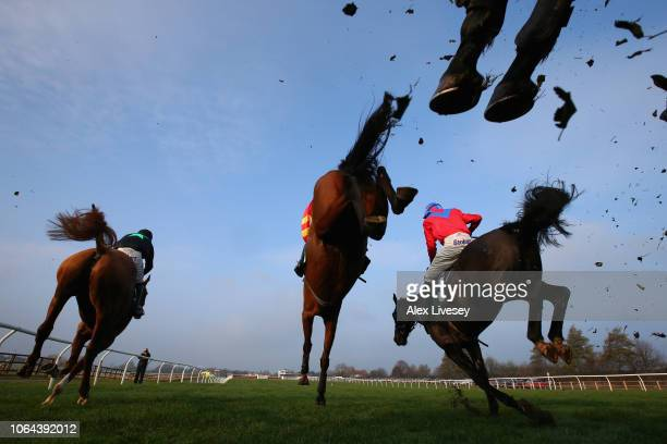 Horses and riders jump a fence during the Racing UK Profits Returned To Racing Handicap Steeple Chase at Catterick Racecourse on November 23 2018 in...