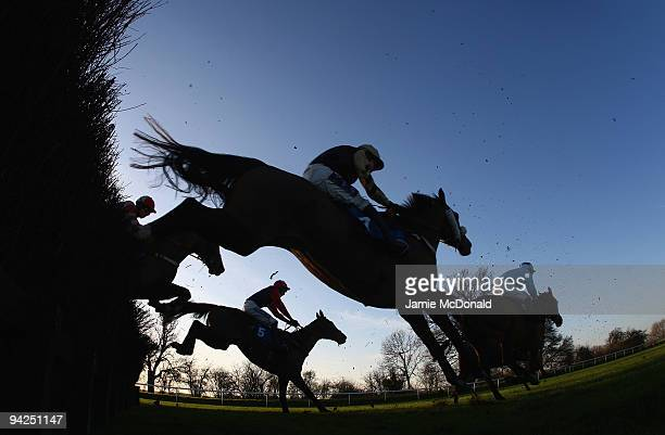 Horses and riders jump the ditch during the Peterborough Steeple Chase run at Huntingdon Racecourse on December 10 2009 in Huntingdon England