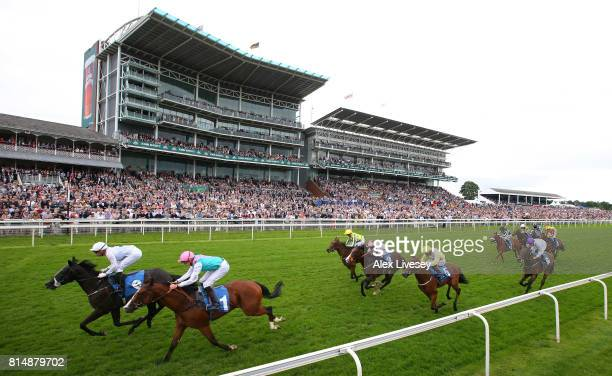 Horses and riders sprint to the finish line during The John Smith's Novice Median Auction Stakes at York Racecourse on July 15 2017 in York England