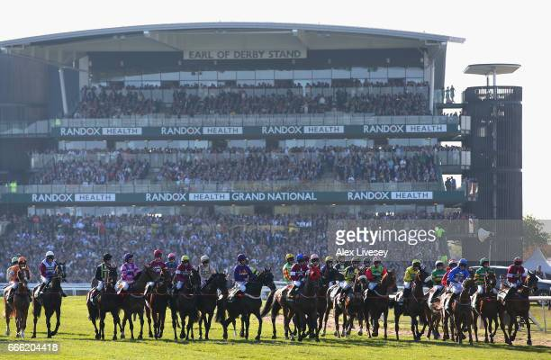 Horses and riders wait to start the 2017 Randox Health Grand National at Aintree Racecourse on April 8 2017 in Liverpool England