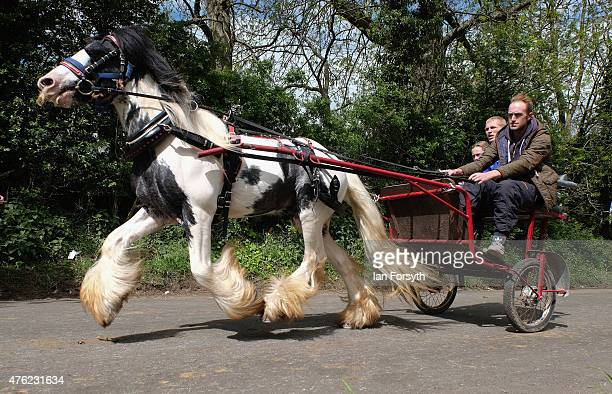 Horses and traps are driven at speed along Flashing Lane during the Appleby Horse Fair on June 7 2015 in Appleby England The fair is an annual...