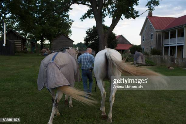 Horses are lead back to the barn on a 18th century farm property on June 30 2017 in Boonsboro Maryland Rural Maryland is increasingly becoming a...