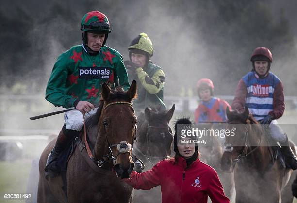 Horses are led back to the parade ground following the first race during the 2016 Coral Welsh Grand National at Chepstow Racecourse on December 27...