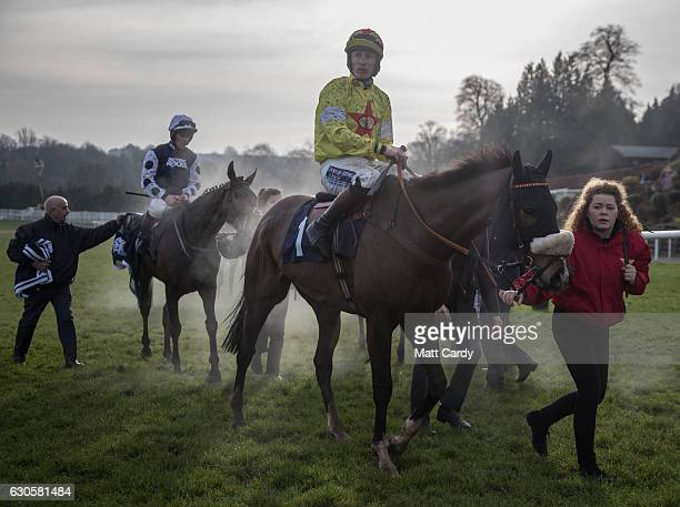 Horses are led back to the parade ring following the second race during the 2016 Coral Welsh Grand National at Chepstow Racecourse on December 27...