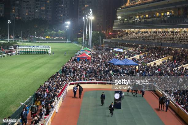 Horses are paraded around the paddock prior to the Race 7 Longines International Jockeys' Championship 3rd Leg at Happy Valley Racecourse on December...