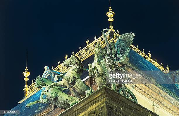 Horses chariot and winged victory night view statue on the facade of the National theatre 18681881 historical centre of Prague Czech Republic 19th...