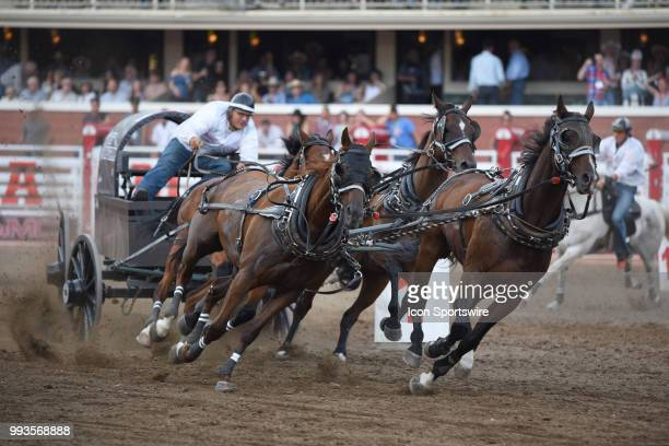 Horses circle the barrels in the GMC Rangeland Derby Chuckwagon Races at the Calgary Stampede on July 6 2018 at Stampede Park in Calgary AB